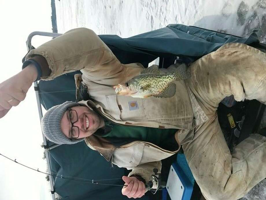 Steve Daitch of Grand Haven, the writer's son-in-law, shows off a black crappie caught through the ice of Wixom Lake. (Steve Griffin/Hearst Michigan)