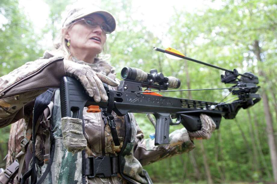 Aili McKeen, a volunteer DEEP Senior Conservation Education Instructor, near Madison, where she hunts white-tailed deer with a crossbow. Photo: Cedar Attanasio / Hearst Connecticut Media / Connecticut Post