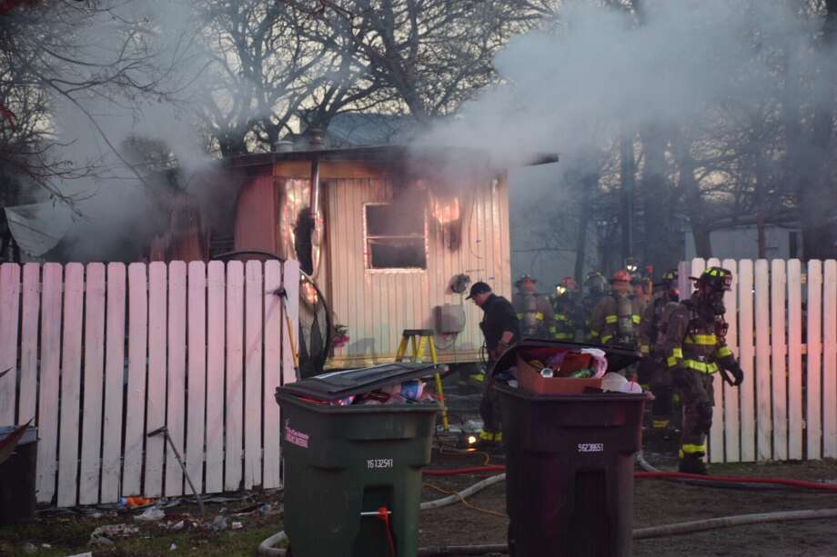 Firefighters are responding to a mobile home fire on the Southwest Side. Photo: Caleb Downs / San Antonio Express-News