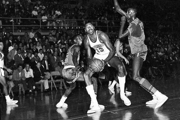 Oct. 26, 1962: Wilt Chamberlain of the San Francisco Warriors is surrounded by Detroit Pistons during the team's first game in S.F. at USF's Memorial Gym.