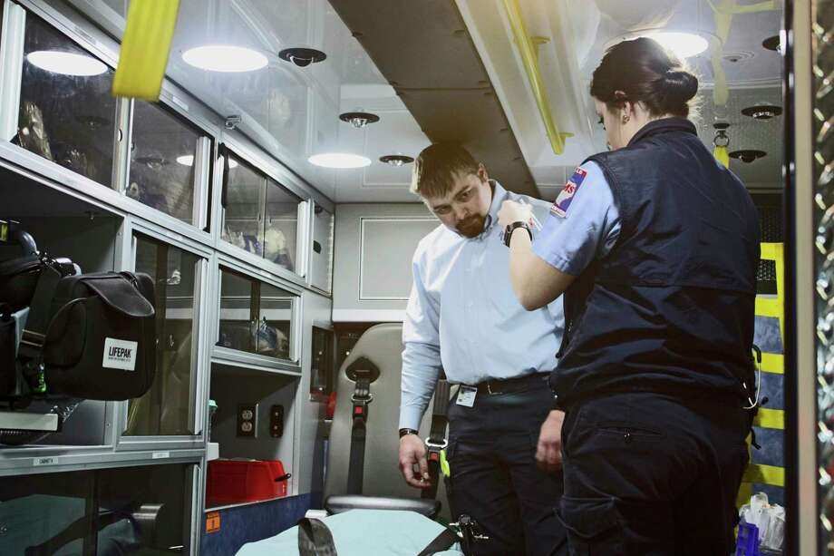 In this Feb. 1, 2018 photo, Amarillo College student Tell Stewart, left, and Amarillo Medical Services' Chelsea Ducheneaux prepare an ambulance for use in Amarillo, Texas. The school and AMS have been teaming up for a while to train the city's next batch of paramedics and EMTs, but this year's approach is different. Students are finishing their education with a final semester of firsthand, one-on-one training with the same paramedic mentor all semester. (Jeff Farris/Amarillo Globe-News via AP) Photo: Jeff Farris, AP / The Amarillo Globe News