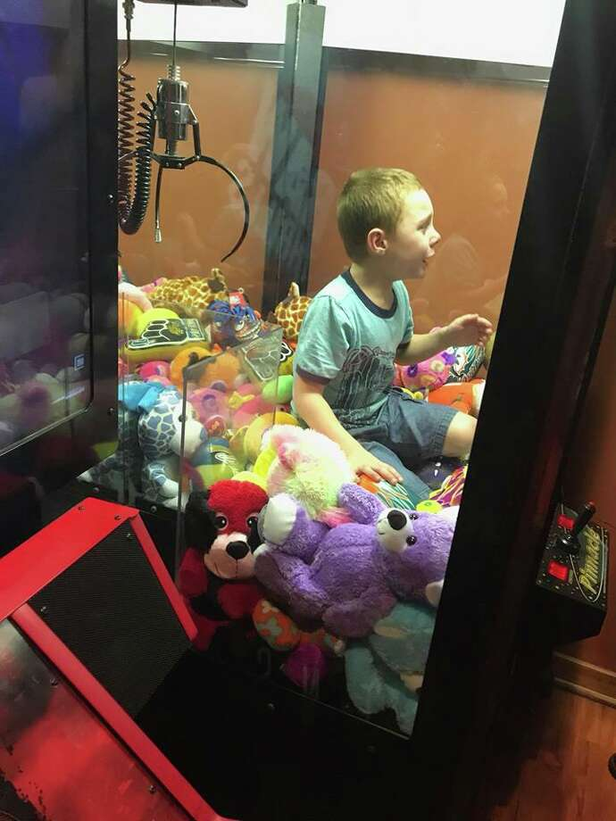 A boy in Florida got stuck inside a toy claw machine. Firefighters rescued him. Photo: Titusville Fire And Emergency Services