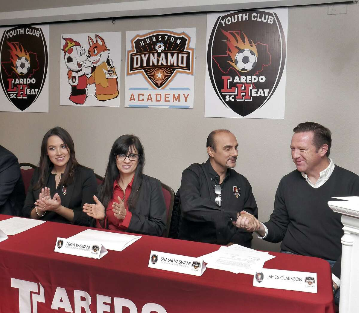 Laredo Heat Youth Soccer Club and Academy President Shashi Vaswani shakes hands with James Clarkson, MLS Houston Dynamo Youth Academy President after signing a partnership agreement between the MLS Houston Dynamo Youth and the Laredo Heat Youth Soccer Club and Academy at a press conference Wednesday, February 7, 2018, at La Quinta on Loop 20. Laredo Heat Youth Academy Player Liaison Edith Ortiz and Academy Vice-President Priya Vaswani look on.