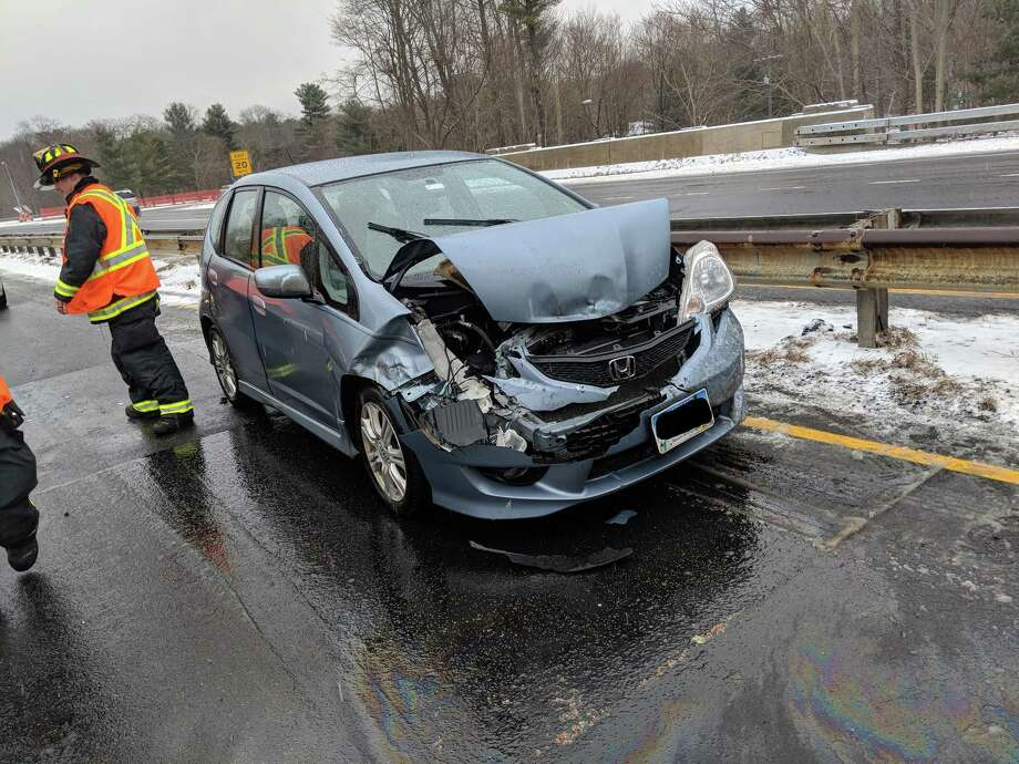 Westport firefighters responded to a car accident near exit 42 on the Merritt Parkway around 11a.m on Feb. 7. Photo: Contributed Photo