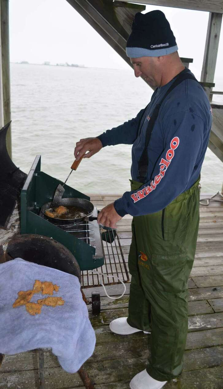 Cooking up a batch of fresh-caught drum fillets, Capt. Joey Farah gives his anglers a break from hooking up with black drum that are popular targets of fishermen along the Texas Gulf Coast this time of year.
