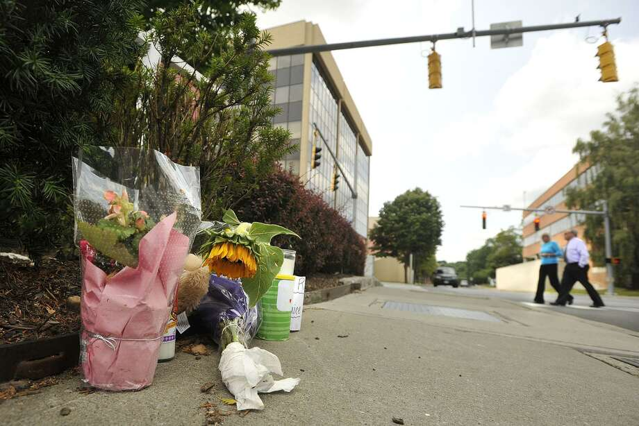 A memorial for Janice Pielert was placed near the corner of Hoyt and Summer streets after she was killed in the crosswalk in 2014. Photo: File Photo / Stamford Advocate