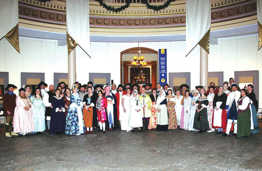 Guests dressed in period costumes at a previous Washington's Birthday Ball. Photo: For The Edge