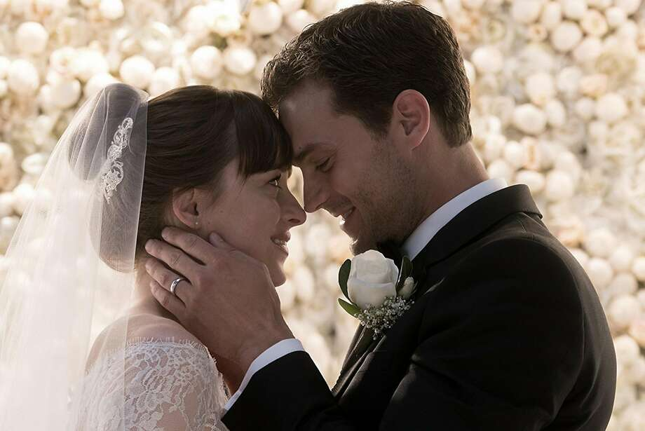 "Dakota Johnson and Jaime Dornan in ""Fifty Shades Freed."" Photo: Universal Pictures, TNS"