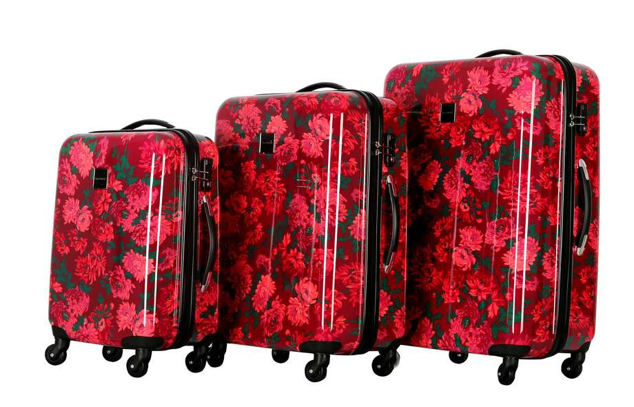 Isaac Mizrahi Irwin 2 Collection in Berry - The hardside 8-wheeled luggage made of durable polycarbonate absorbs impacts and features 360-degree multi-directional spinner wheels that glides easily on all surfaces. LongLat Photo: Courtesy LongLat