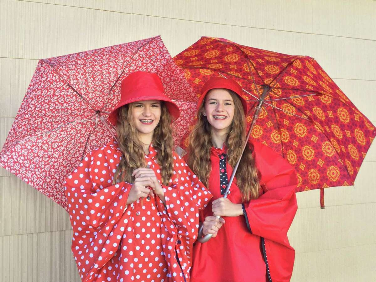 Rain ensembles from Totes - Tejeda Middle School twins Addison (left) and Audrey model coordinated rain ensembles from Totes that include fashionable light-weight umbrellas, hats and reversible ponchos with side snap closures and a big zipper pocket.