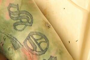 """The Hidalgo County Sheriff's Office is searching for information on a body found in the Rio Grande River Feb. 3, 2018.  The body is male and has tattoos. The tattoo above reads, """"Sombra."""""""