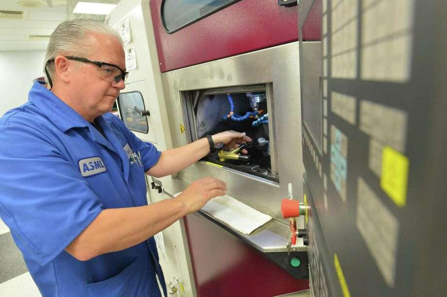 Senior Technician Paul Hospodar works at a small lens generator in the optical fabrication line at ASML. Photo: Alex Von Kleydorff / Hearst Connecticut Media / Norwalk Hour