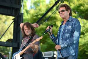 BAKERSFIELD, CA - MAY 23:  (L-R) Guitarist John Roth and singer Mickey Thomas of classic rock band Starship perform onstage on May 23, 2015 in Bakersfield, California.  (Photo by Scott Dudelson/Getty Images)