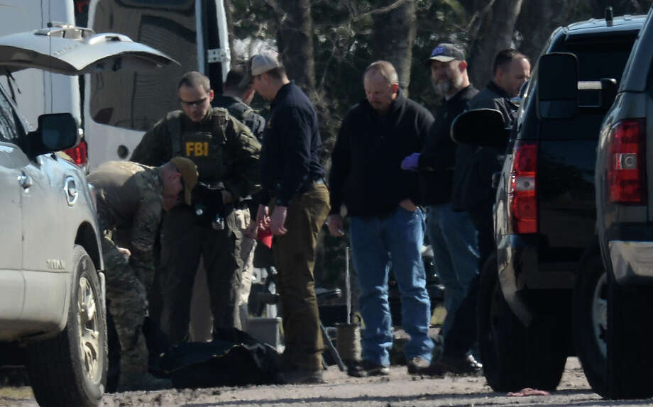 Beaumont Police and the FBI raid a home on Belomont Street near College Street Thursday morning.  Photo taken Thursday, February 08, 2018 Guiseppe Barranco/The Enterprise Photo: Guiseppe Barranco