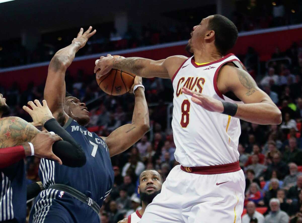 Cleveland Cavaliers forward Channing Frye (8) blocks a shot by Detroit Pistons forward Stanley Johnson (7) during the first half of an NBA basketball game Tuesday, Jan. 30, 2018, in Detroit. (AP Photo/Duane Burleson)
