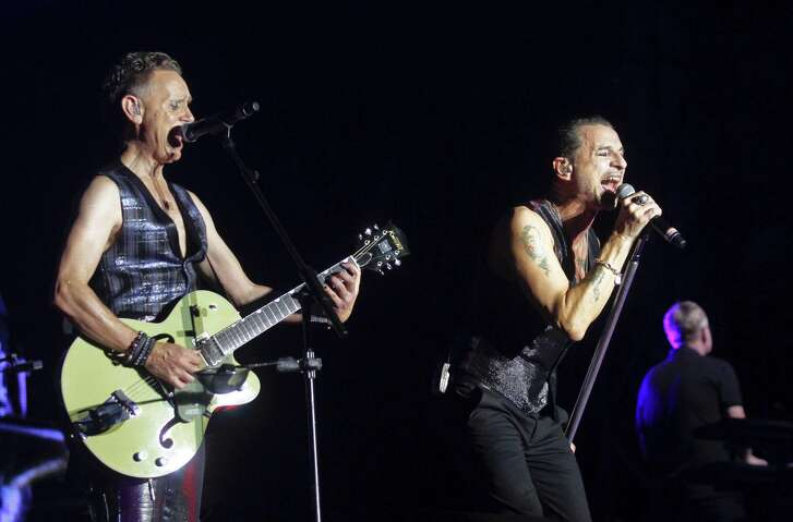 Depeche Mode's Martin Gore, left, and Dave Gahan perform on Day 1 of the 2013 Austin City Limits Music Festival at Zilker Park on Friday, Oct. 4, 2013 in Austin, Texas. (Photo by Jack Plunkett/Invision/AP)