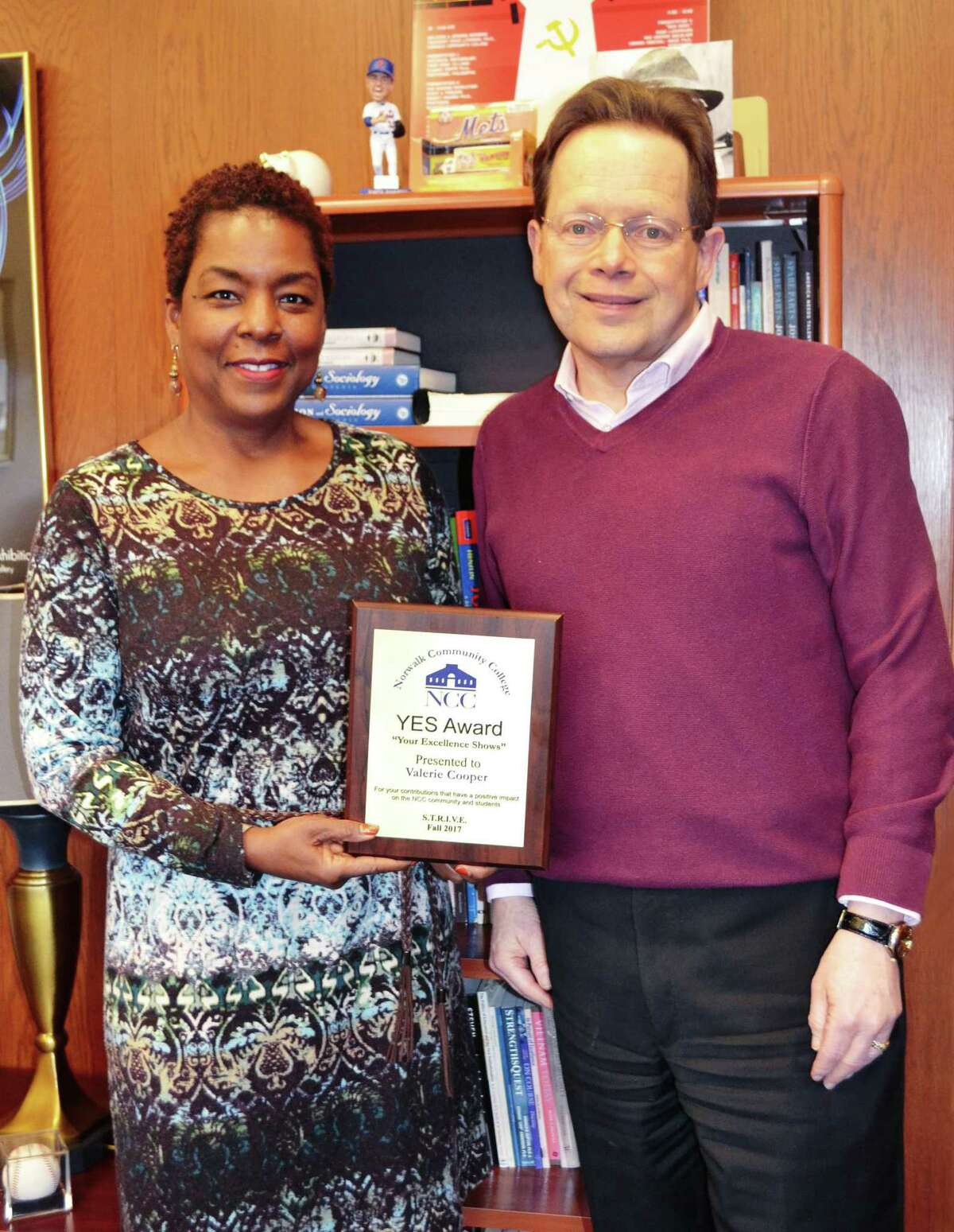 Pictured is one of the four YES Award winners Valerie Cooper (left) and NCC President David L. Levinson, Ph.D. Other winners included Andrea Pizone, Harold Winston and Diane Donovan.