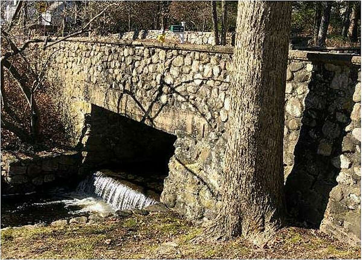 A stone bridge built in the early 20th century sits at the intersection of Route 46 and 56 Evergreen Ave. in Westport.