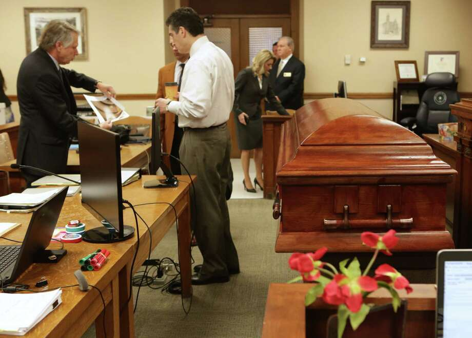 "Robert ""Dick"" Tips and his wife Kristin Tips stand at the courtroom door in the 131st Civil District Courtroom, as lawyers prepare for the trial, next to a coffin they had brought in for Tip's trial on Thursday, Feb. 8, 2018. Photo: Bob Owen, San Antonio Express-News / San Antonio Express-News"