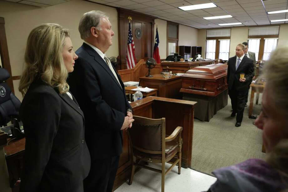 Robert Dick Tips and his wife, Kristin Tips, stand in the 131st Civil District Courtroom next to a coffin they had brought in for the jurors to see Thursday. Photo: Bob Owen /San Antonio Express-News / San Antonio Express-News