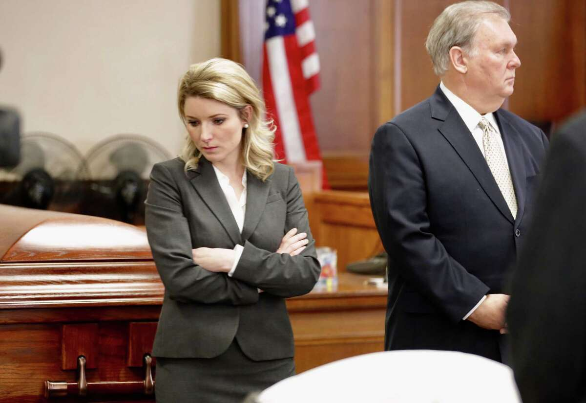 Robert Dick Tips and his wife, Kristin Tips, stand in the 131st Civil District Courtroom next to a coffin they had brought in for the jurors to see Thursday.