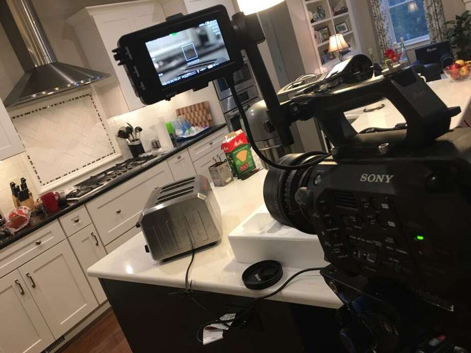 Camera set up for filming a house tour. (Filmworks109)