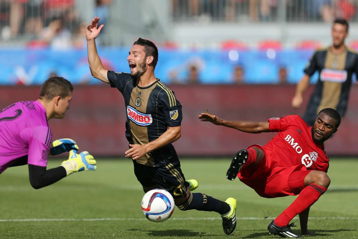 July 18, 2015: Philadelphia Union midfieder Eric Bird (21) is taken down by Toronto FC defender Ashtone Morgan (5) in the box during a MLS game between the Philadelphia Union and Toronto FC at BMO Field in Toronto, ON. (Photo by Kevin Sousa/Icon Sportswire/Corbis via Getty Images)