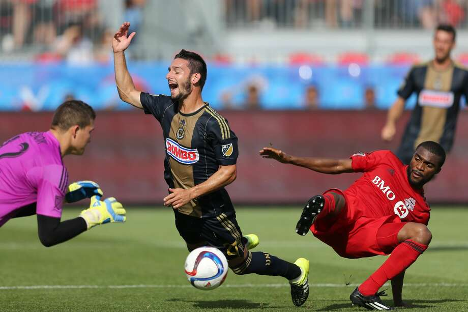 July 18, 2015: Philadelphia Union midfieder Eric Bird (21) is taken down by Toronto FC defender Ashtone Morgan (5) in the box during a MLS game between the Philadelphia Union and Toronto FC at BMO Field in Toronto, ON. (Photo by Kevin Sousa/Icon Sportswire/Corbis via Getty Images) Photo: Icon Sports Wire/Corbis Via Getty Images