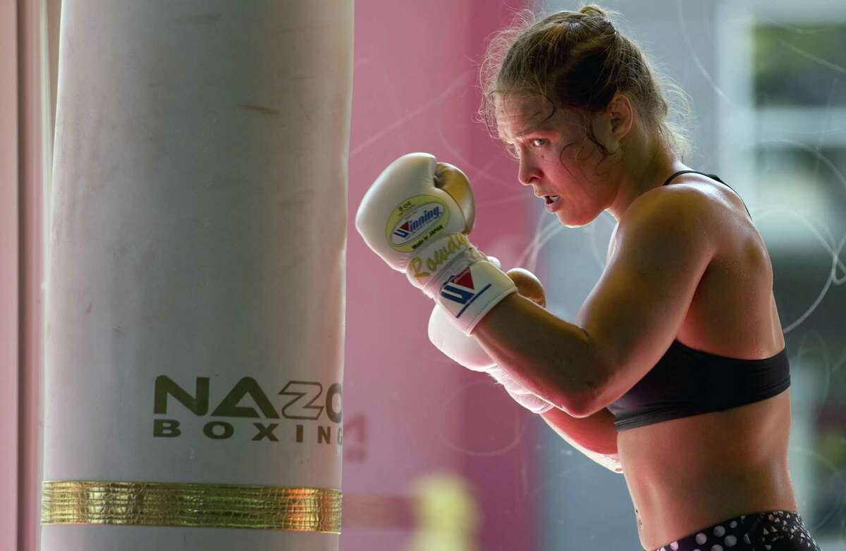 Mixed martial arts fighter Ronda Rousey, a former UFC champion, signed as a WWE superstar in January 2018.