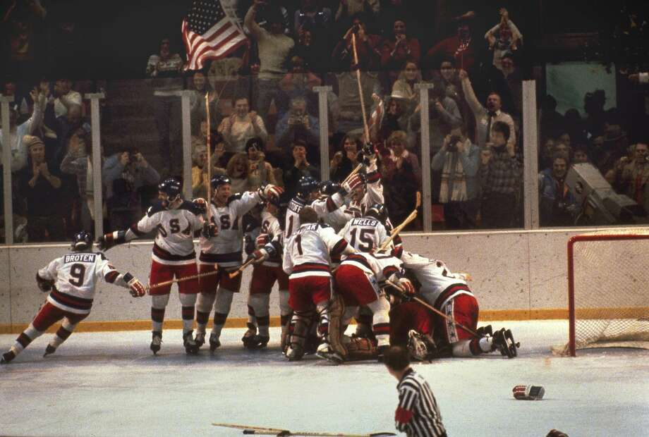 FILE - In this Feb. 22, 1980, file photo, the U.S. hockey team pounces on goalie Jim Craig after a 4-3 victory against the Soviets in the 1980 Olympics in Lake Placid, N.Y.  A court petition filed Nov. 7, 2018 in state Supreme Court in Albany claims a former finance director for the Olympic Regional Development Authority has been charged with stealing funds to cover-up massive alcohol and entertainment charges ORDA racks up for their activities, which includes a 1980 Miracle on Ice Fantasy Camp featuring former players. (AP Photo, File) Photo: Uncredited/AP