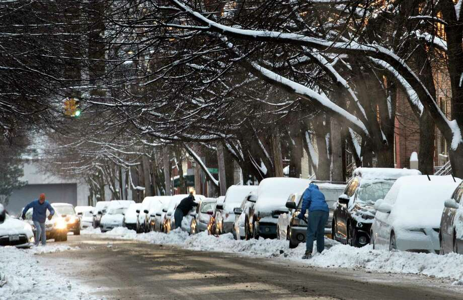 People dig their cars out on Hudson Avenue Thursday Feb. 8, 2018 in Albany, N.Y. after a snow storm that covered the area with different amounts of snow.   (Skip Dickstein/Times Union) Photo: SKIP DICKSTEIN, Albany Times Union