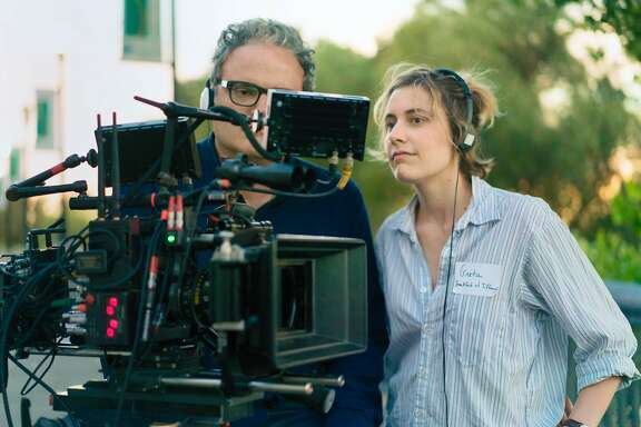 """This image released by A24 Films shows director Greta Gerwig on the set of """"Lady Bird."""" Gerwig is among the nominees at the Directors Guild Awards, being held Saturday, Feb. 3, 2018, in Beverly Hills, Calif. The untelevised ceremony also awards achievements in commercial, scripted series and live television directing. (Merie Wallace/A24 via AP)"""