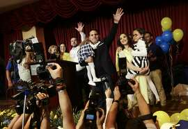 FILE - In this Feb. 4, 2018 file photo, presidential candidate Fabricio Alvarado with National Restoration Party gives his victory speech after general elections in San Jose, Costa Rica. Alvarado, the surprise winner of Sunday�s vote is a 43-year-old journalist and Christian singer whose songs can be found on Spotify. On April 1 he will face off against governing party candidate Carlos Alvarado, no relation. (AP Photo/Arnulfo Franco, File)