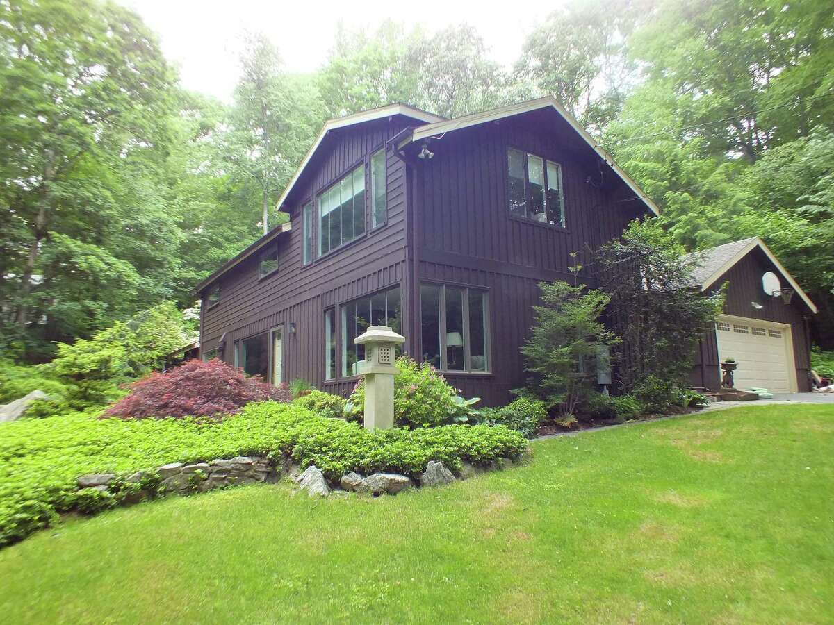 The contemporary house at 7 Highwood Lane sits on property in the towns of Wilton and Westport.
