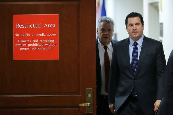 WASHINGTON, DC - FEBRUARY 06:  House Intelligence Committee Chairman Devin Nunes (R-CA) (2nd L) and Rep. Peter King (R-NY) leave the committee's secure meeting rooms in the basement of the U.S. Capitol House Visitors Center February 6, 2018 in Washington, DC. The committee voted unanimously Monday night to send a Democratic memo rebutting claims of bias in the Russia investigation FISA court application to the White House.  (Photo by Chip Somodevilla/Getty Images)