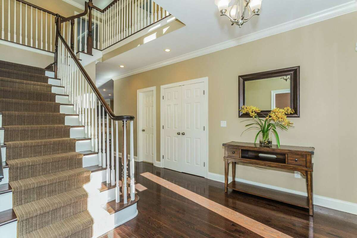 The 3,834-square-foot house was built in 1999 and features an open floor plan and an easy flow from room to room, which is evident from the two-story foyer.