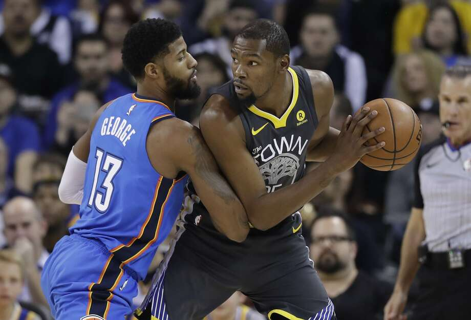 Golden State Warriors' Kevin Durant is defended by Oklahoma City Thunder's Paul George (13) during the first half of an NBA basketball game Tuesday, Feb. 6, 2018, in Oakland, Calif. (AP Photo/Marcio Jose Sanchez) Photo: Marcio Jose Sanchez, Associated Press