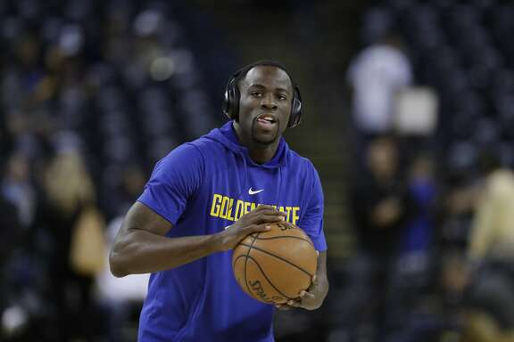 Golden State Warriors' Draymond Green warms up before an NBA basketball game against the Oklahoma City Thunder Tuesday, Feb. 6, 2018, in Oakland, Calif. (AP Photo/Marcio Jose Sanchez)
