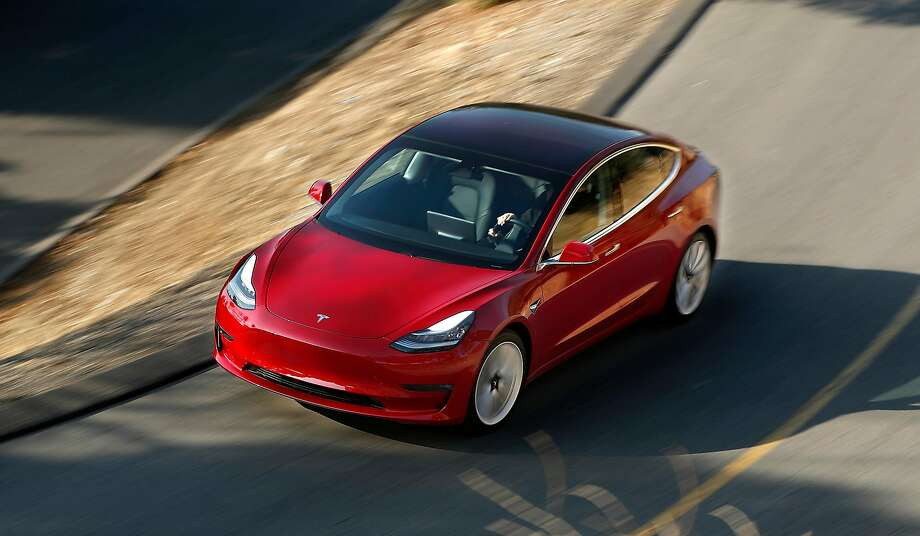 Many reservation holders for Tesla's Model 3 have been told that deliveries are being delayed. Photo: Mel Melcon, TNS