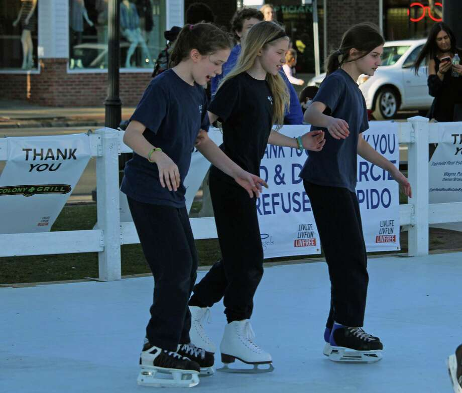 Warm weather and a synthetic ice rink drew crowds to Sherman Green last February. Photo: Genevieve Reilly / Hearst Connecticut Media File Photo / Fairfield Citizen