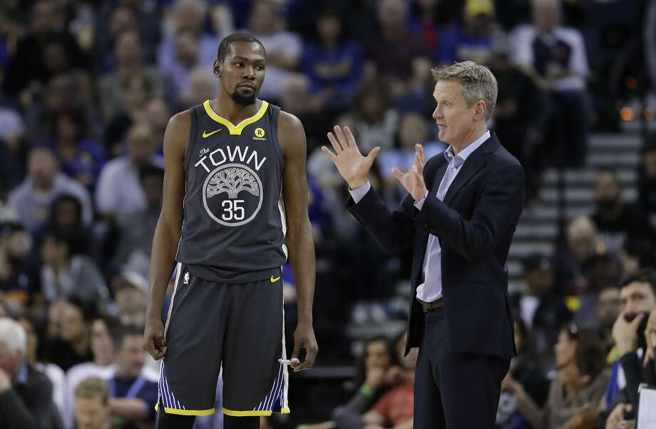 Golden State Warriors head coach Steve Kerr, right, talks to Kevin Durant (35) during the second half of an NBA basketball game against the Oklahoma City Thunder Tuesday, Feb. 6, 2018, in Oakland, Calif. (AP Photo/Marcio Jose Sanchez) Photo: Marcio Jose Sanchez, Associated Press