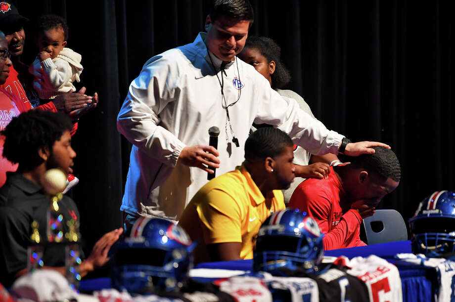 William Peevey West Brook's coach places his hand on Steven Johnson head during National Signing Day on Wednesday. Photo taken Wednesday, February 07, 2018 Guiseppe Barranco/The Enterprise Photo: Guiseppe Barranco, Photo Editor / Guiseppe Barranco ©