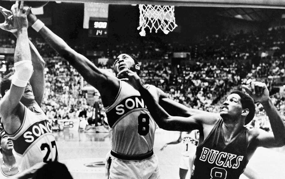 Seattle Supersonic Lonnie Shelton (8) reaches for a rebound along with his teammate John Johnson (27) as Milwaukee Buck Marques Johnson (8) looks on during their NBA playoff game, April 20, 1980, Seattle, Wash. (AP Photo/Grant M. Haller) Photo: Grant M. Haller/ASSOCIATED PRESS