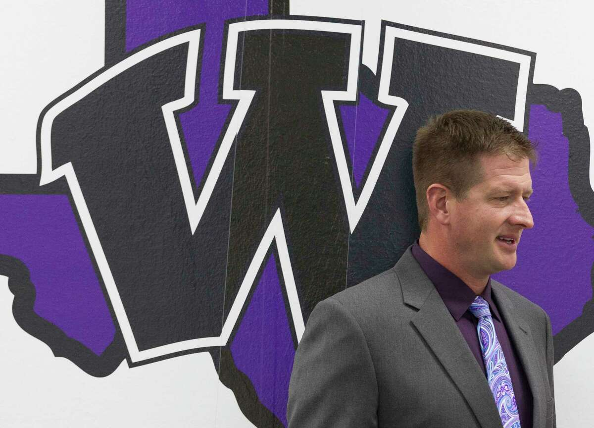 Michael Wall, former offensive coordinator at Lake Travis High School, is seen after being announced as Willis High School's new athletic coordinator and football coach, Wednesday, Feb. 7, 2018, in Willis.