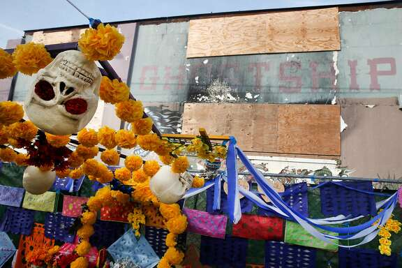 A memorial is erected in front of the Ghost Ship warehouse in Oakland, Calif. on Saturday, Dec. 2, 2017 for the 36 people that died in the fire at the site one year ago.