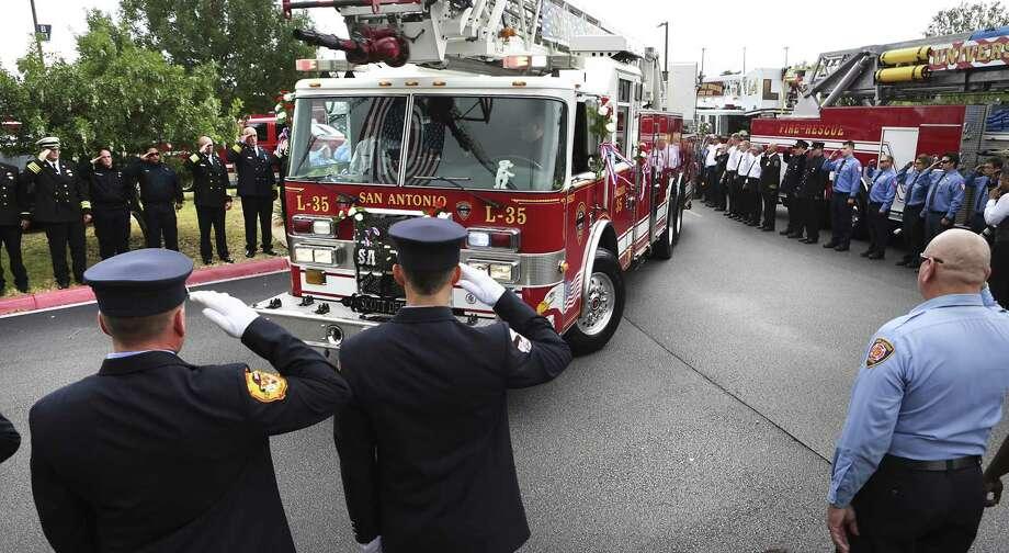 The firetruck that Scott Deem worked on arrives at the Community Bible Church on Friday, May 26, 2017. Photo: Bob Owen, Staff / San Antonio Express-News / ©2017 San Antonio Express-News
