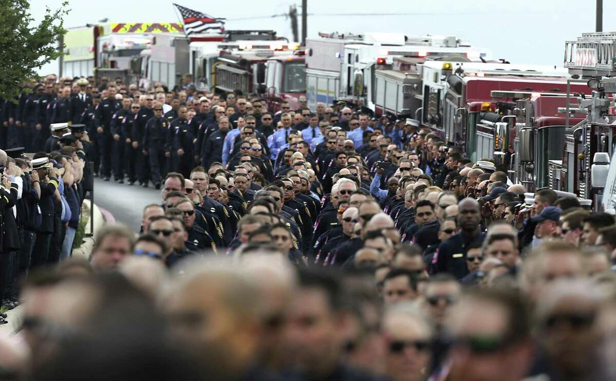Hundreds of firefighter process to the funeral for San Antonio Firefighter Scott Deem at Community Bible Church on Friday, May 26, 2017.