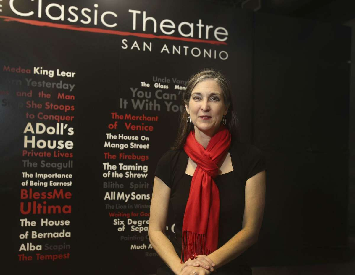 Kelly Hilliard Roush poses in the lobby of Classic Theatre, which she serves as artistic and executive director. The entry to the theater includes a wall commemorating every show the company has produced in its 10 year history.