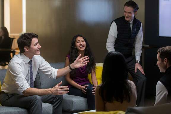 Canadian Prime Minister Justin Trudeau speaks with engineers of AppDirect while touring their San Francisco office Thursday, Feb. 8, 2018  in San Francisco, Calif.