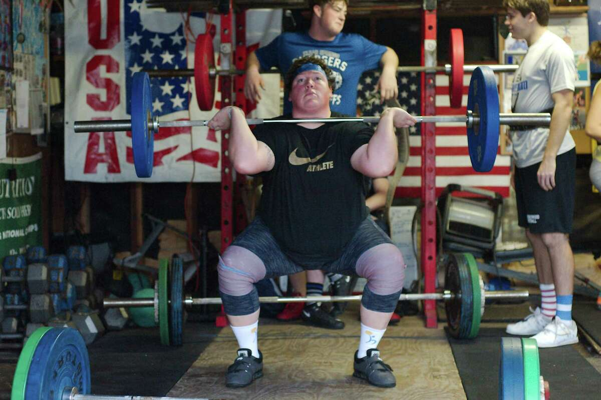 Friendswood world champion weight lifter Sarah Robles works through her routine as she trains.